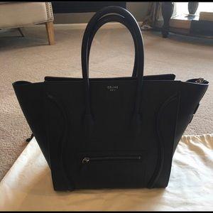 Black Celine mini luggage.